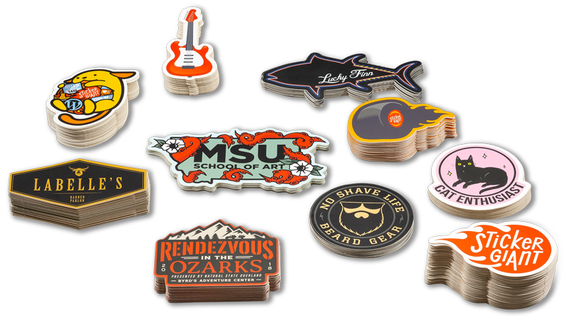 Stacks-of-Die-Cut-Stickers-in-different-shapes-to-show-the-backing-is-cut-to-the-shape-of-the-sticker