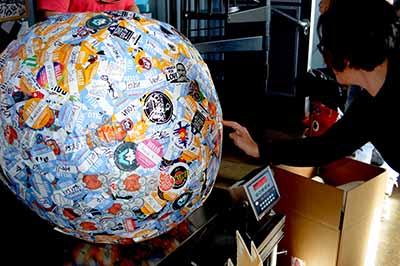 Saul the World's Largest Sticker Ball on National Sticker Day in Longmont CO with the StickerGiant Team