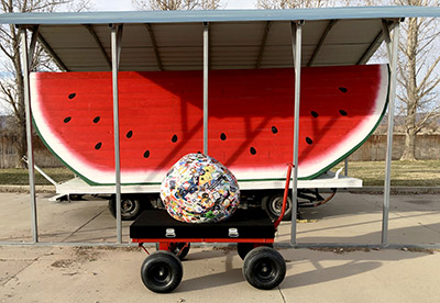 Saul-the-World_s-Largest-Sticker-Ball-Met-the-World_s-Largest-Watermelon-Slice-in-Utah-with-StickerGiant
